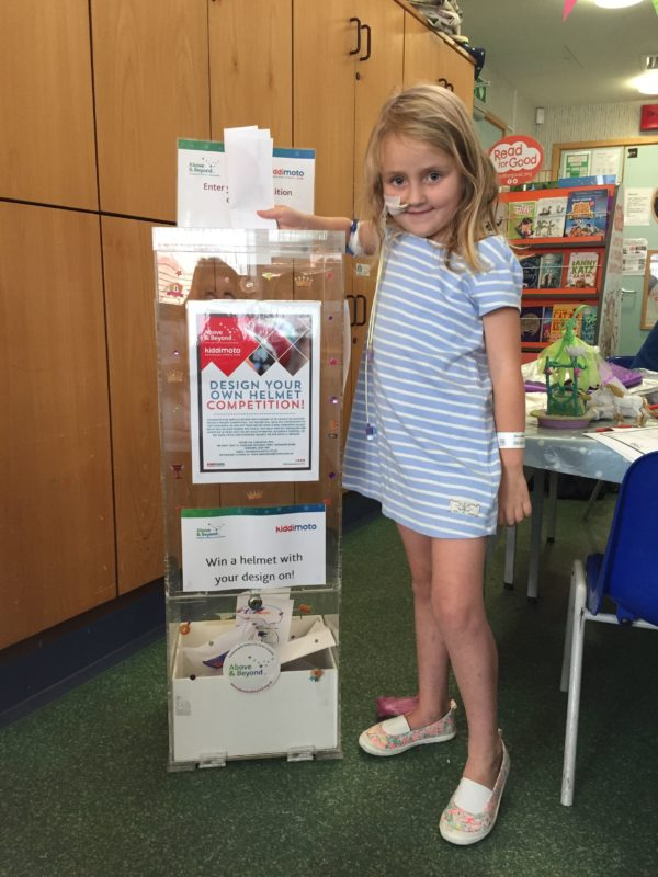 A child shows us the collection box at Bristol Children's Hospital