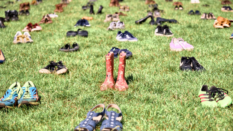 Photo: Some of the 296 pairs of shoes placed in grid-like fashion on College Green