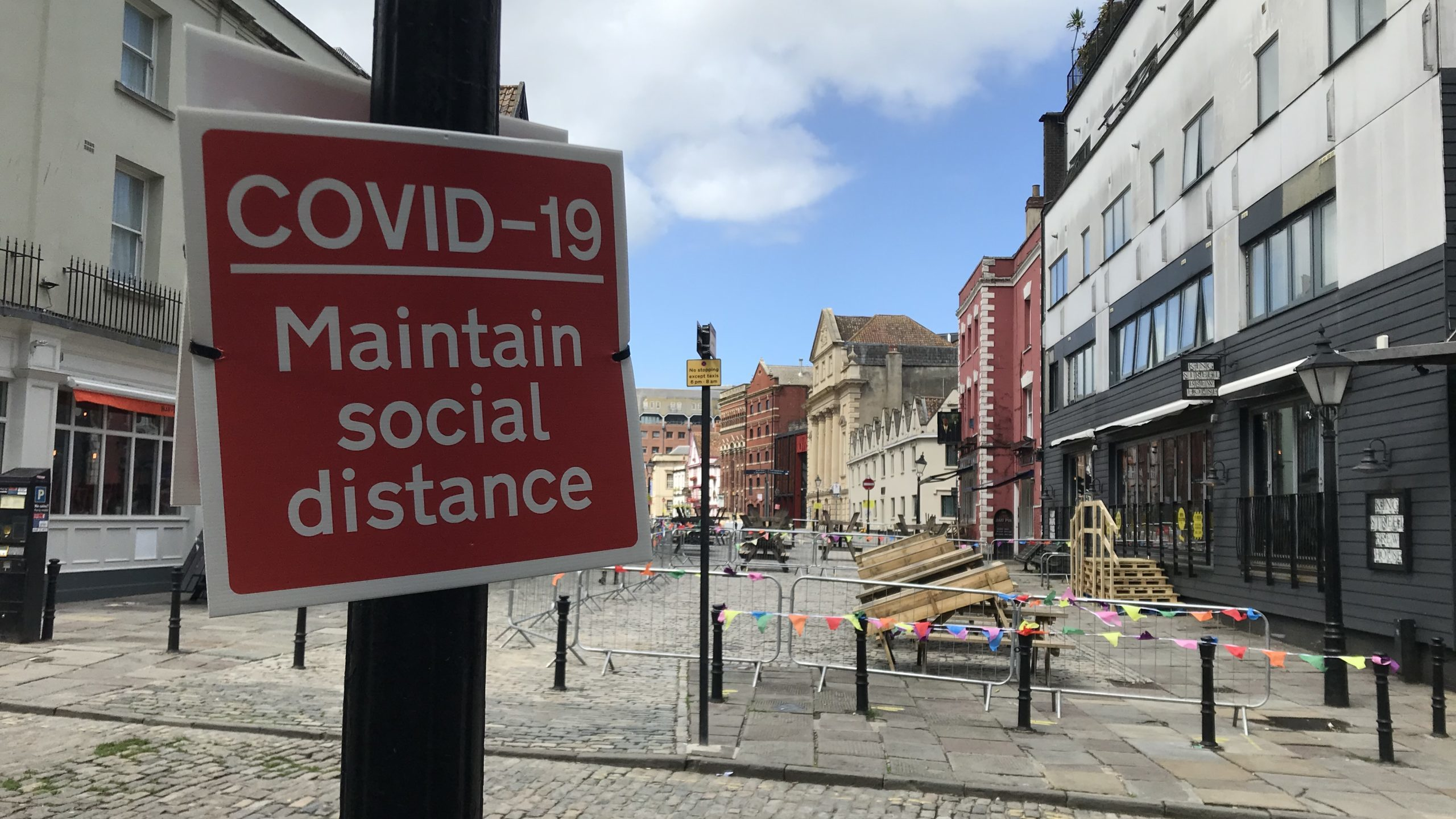 Photo: Sign on King Street that says 'COVID-19 Maintain social distance'.