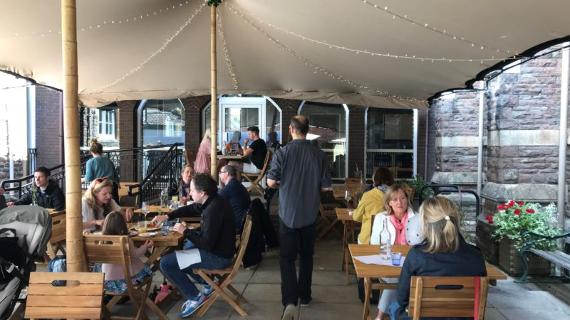 A Bristol restaurant has moved its dining room into a churchyard